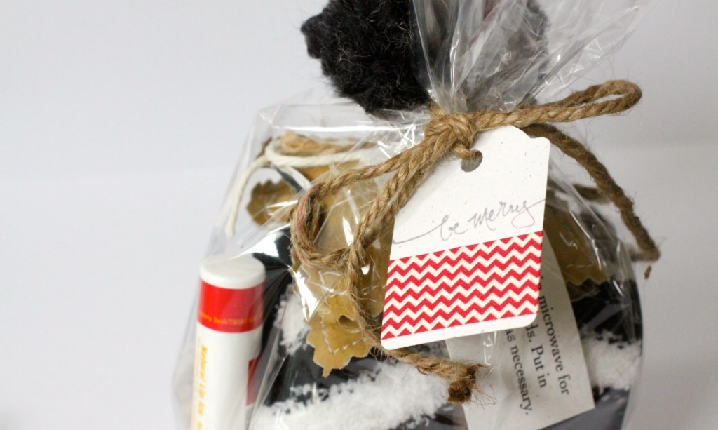 Gifts for Girls. Mittens, hand warmers, lip balm, barrette. All wrapped up with a pretty yarn Pom Pom. Love of Home.