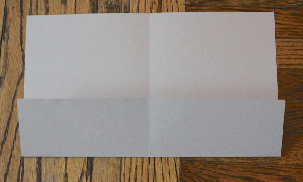 """first two steps. Cut the 8 1/2 x 11 paper so you have two 8 1/2 x 5 1/2 pieces. Using the scoring tool to score each piece at 4 1/4 on the 8 1/2"""" side. Fold on score mark. You should end up with a notecards 5 1/2"""" x 4 1/4"""". Cut your decorative papers just smaller than the notecards or a little more if you want a border. Adhere a decorative paper to each notecard. For this sett I made 8. You can stamp the envelopes if you like. I stamped the recipient's initial on the back flaps to personalize it. Cut your 12 x 12"""" card stock to 12 x 9 and score so you create a flap inside the folder to hold the cards and envelopes. Decorate cover and tied closed. I used jute since I was going for a more masculine feel and go with the Cape Cod theme of the cards."""