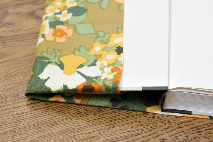 covering books with fabric for the seasons.